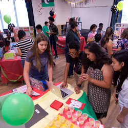 Students share their projects during World's Fair.