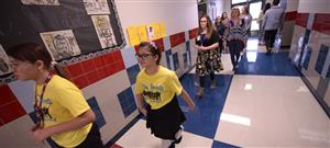 Students walking in the hallway.